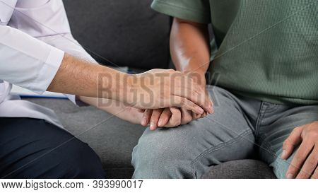 Patient Receiving Bad News, He Is Desperate, Doctor Support And Comforting His Patient With Sympathy