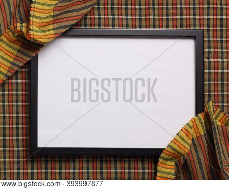 Top View Of Blank Photo Frame On Thai Fabric Texture