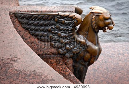 Griffin - bronze winged lion on the University Embankment in front of the Academy of Arts. St. Petersburg. Russia poster