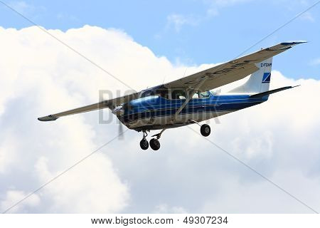 Airplane Approaching Landing After Dropping Group Of Skydivers