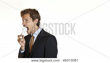 Businessman Biting Lightbulb