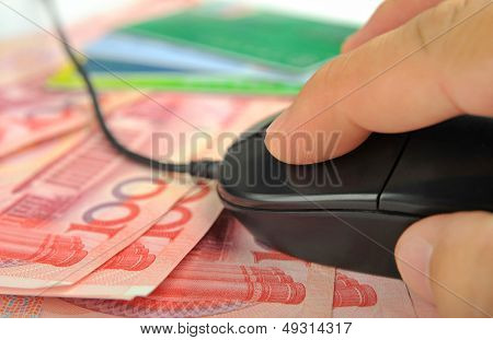 Hand use computer Mouse on money