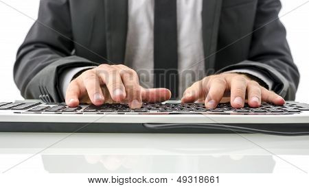 Front View Of Insurance Agent Typing On Computer