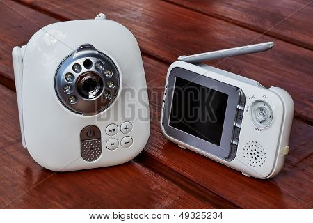 The clouse-up baby monitor for security of the baby poster