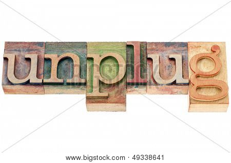 unplug  - lifestyle or information overload concept  - isolated text in letterpress wood type