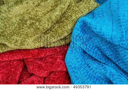 female colourful scarves as a background