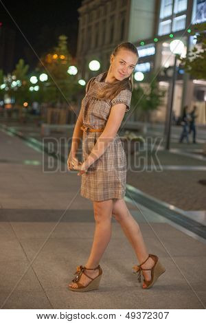 Beautifull girl stay at square in the night