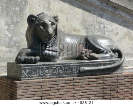 An egyptian ancient lion statue at the Vatican museums poster