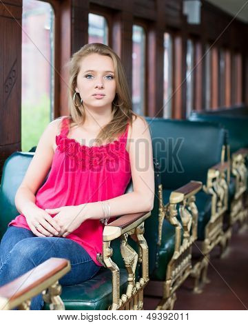 Teenage Girl Sitting In Old Vintage Train Car
