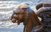 Griffin - bronze winged lion on the University Embankment St. Petersburg. Russia poster