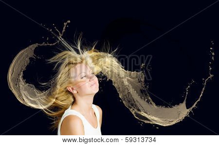 Young attractive blond girl with hair in color splashes