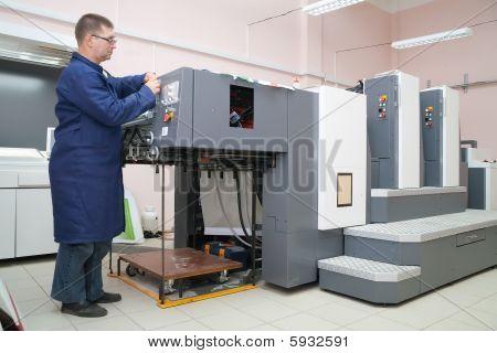 Printer Working At His New Offset Machine