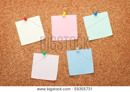 Blank postit notes on cork wood notice board poster