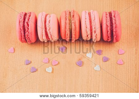 vintage strawberry, raspberry and rhubarb macaroons on wooden table