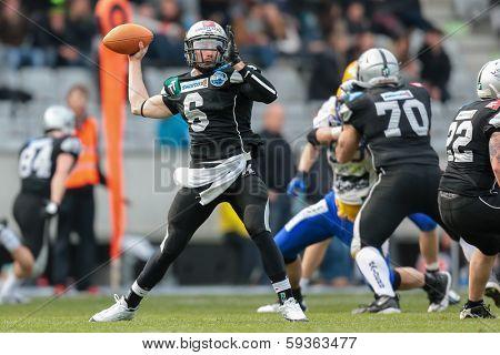 INNSBRUCK,  AUSTRIA - MARCH 23 QB Kyle Callahan (#6 Raiders) throws the ball during the AFL football game on March 23, 2013 in Innsbruck, Austria.