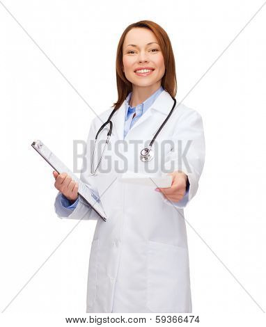 healthcare and medicine concept - smiling female doctor with clipboard and stethoscope