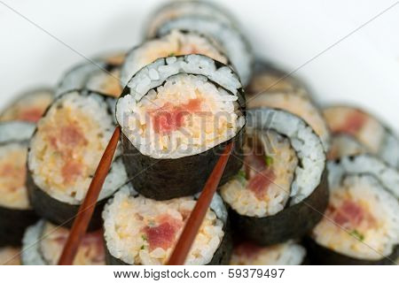 Spicy Tuna Roll Being Selected With Chopsticks