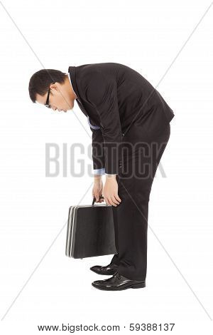 Listless Businessman Stoop And Holding Briefcase