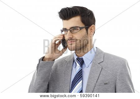 Handsome young businessman talking on mobilephone, smiing.