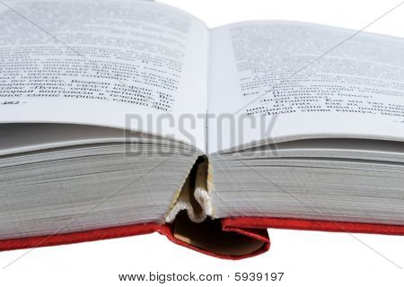 opened book with red hardcover