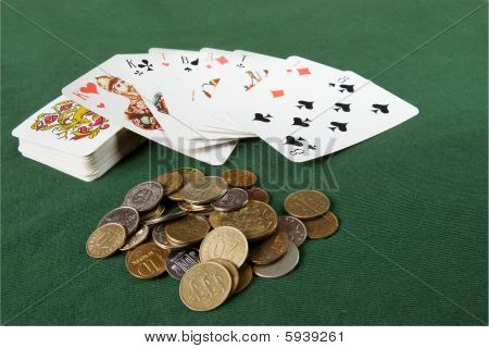 set of cards and coins