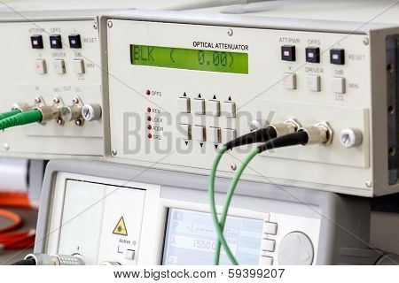 Modern fiber optic testing equipment - analyzer on white background poster