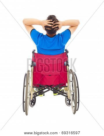 handicapped man sitting on a wheelchair and painful pose poster