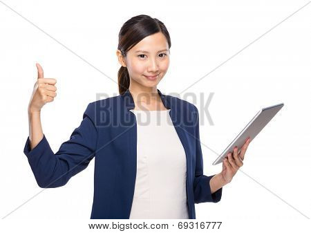 Woman thumb up with tablet