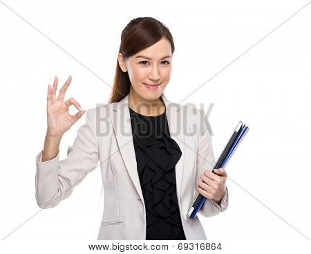 Businesswoman hold clipboard and laptop ok sign