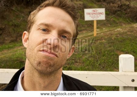 A Man Passing No Trespassing Sign