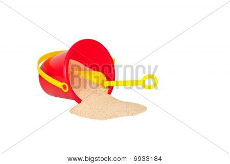 Summer Fun! Red Bucket, Yellow Shovel, And Sand Isolated On White.