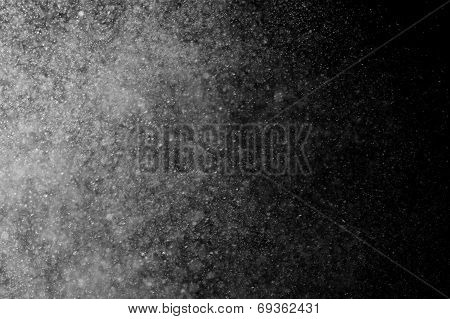 Abstract water spray on a black background poster