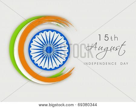 Creative background for 15th of August, Indian Independence Day celebrations with Asoka Wheel and Indian tricolors stripe on grey background.