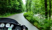 Motorcycle Riding through a Tennessee Forest off the Cherohala Skyway National Scenic Byway on River Road poster