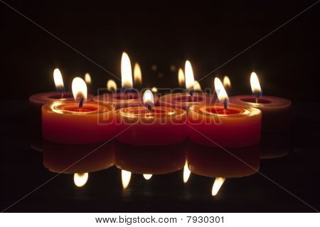 Red And Purple Candles On Black Background