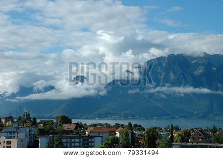 Mountains Geneve lake and buildings in La Tour-de-Peilz in Switzerland poster