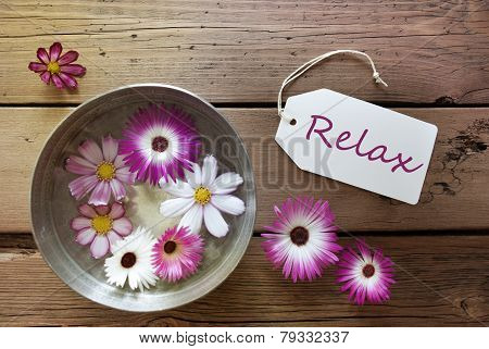 Silver Bowl With Cosmea Blossoms With Text Relax