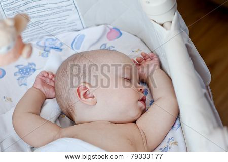 Cute Baby Sleeping Sweetly In The Cradle
