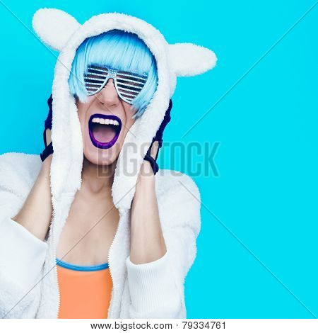 Screaming Crazy Girl In Hoodie Teddy Bear On A Blue Background.