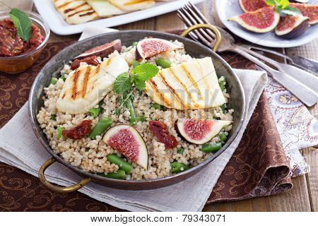 Spiced cous-cous with grilled haloumi and figs poster