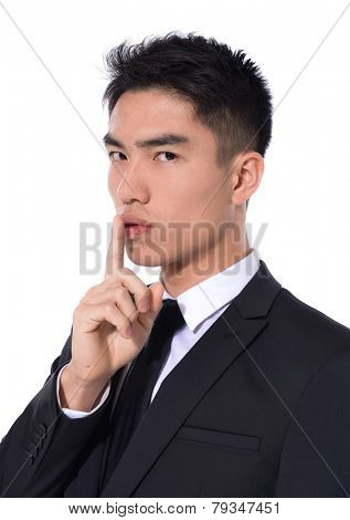 businessman showing silence gesture, poster