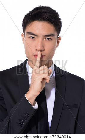 Elegant young businessman showing silence gesture, poster