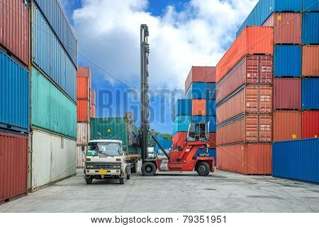 Crane lifter loading container box into truck in import export logistic zone poster