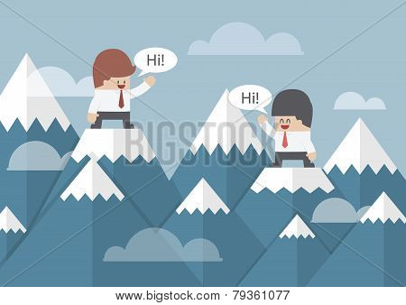 Two Businessmen Standing On The Top Of Mountain