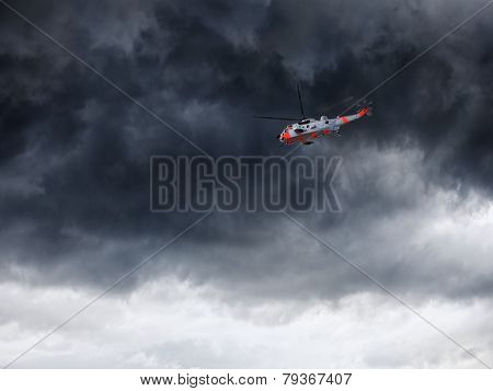 Helicopter And Dark Clouds