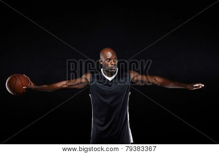 Fit Young Basketball Player With Arms Outstretched