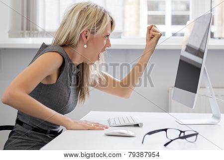 Woman yelling to computer