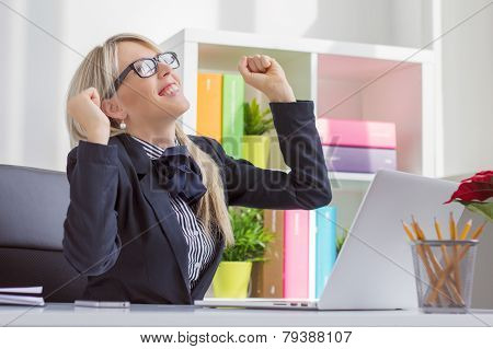 Happy business woman enjoying success at work