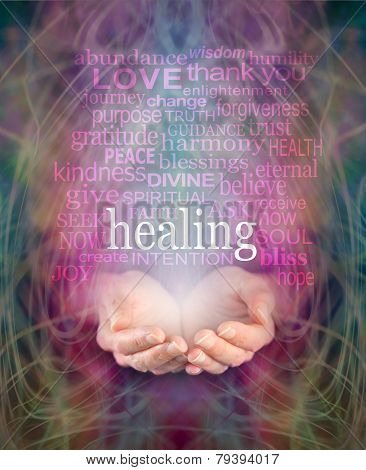 Female cupped hands with the word 'healing' floating above surrounded by a word cloud of healing related words on a swirling misty energy background poster