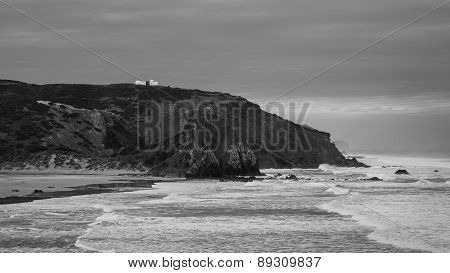 Lonely House Overseeing A Deserted Beach In Western Portugal While The Waves Are Breaking Below. The